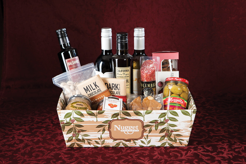 Wine Gift Basket  The Wine Basket includes salami, crackers, wine (or sparkling cider, if you prefer), Fresh to Market Extra Virgin Olive Oil and Balsamic Vinegar, Fresh to Market chocolate, olives and nuts.