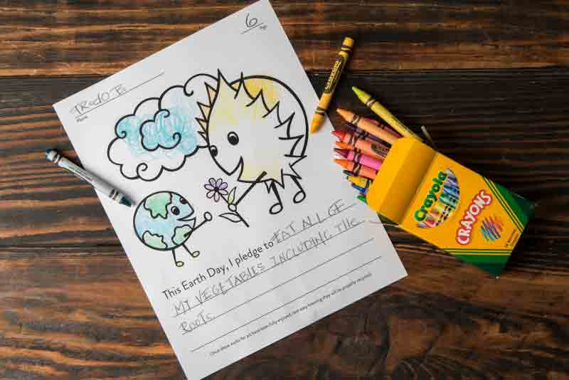 Earth Day Green Pledge Coloring Contest Page with Crayons