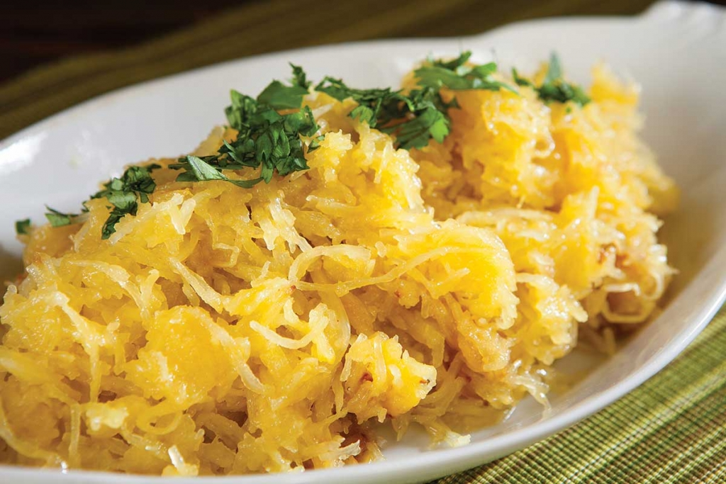spaghetti squash garnished with olive oil and parsley