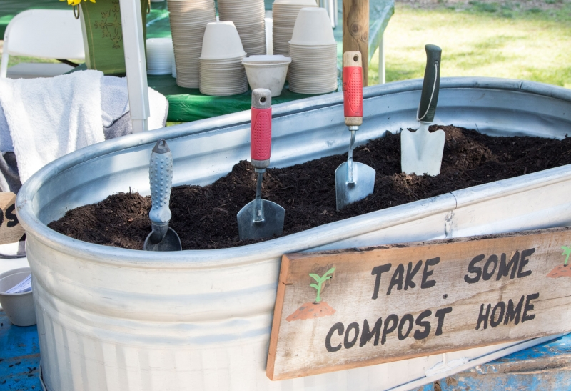 Tub of compost with shovels