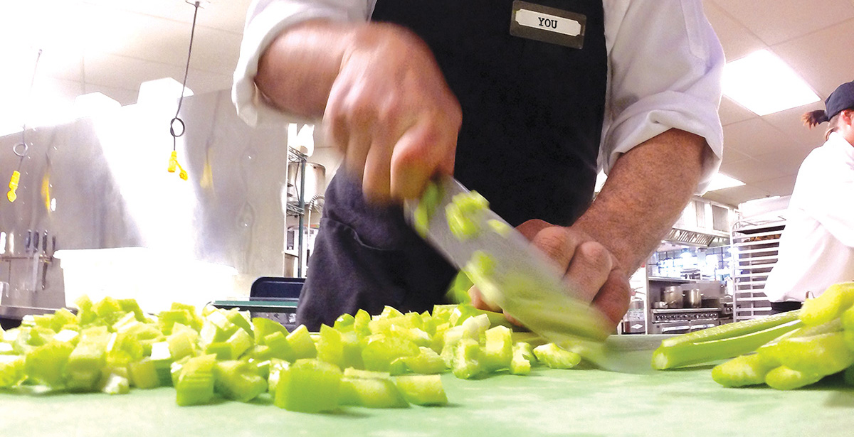 chef chopping celery