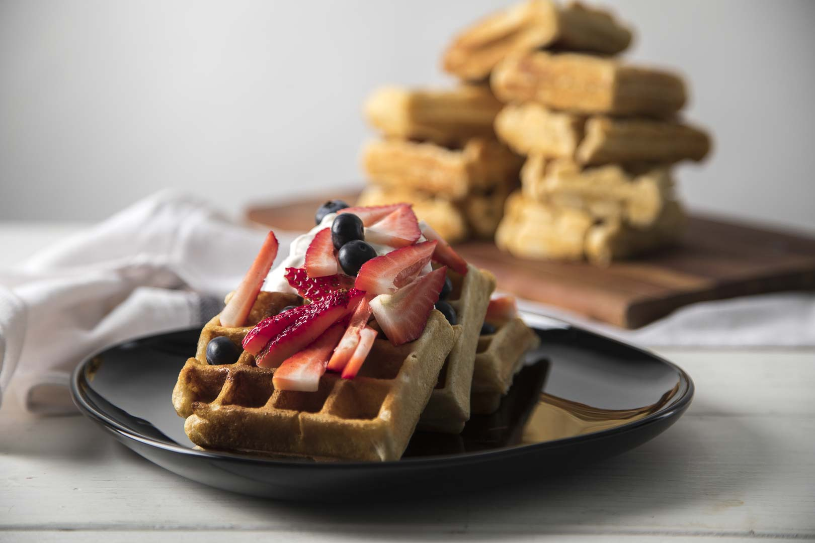 waffles and berries on a plate