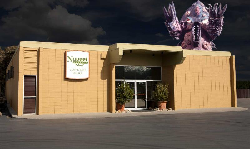 A giant monster attacks the Nugget Markets Corporate Office