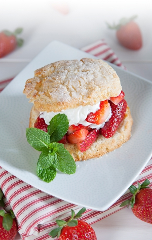 strawberry shortcake on a plate with a sprig of mint