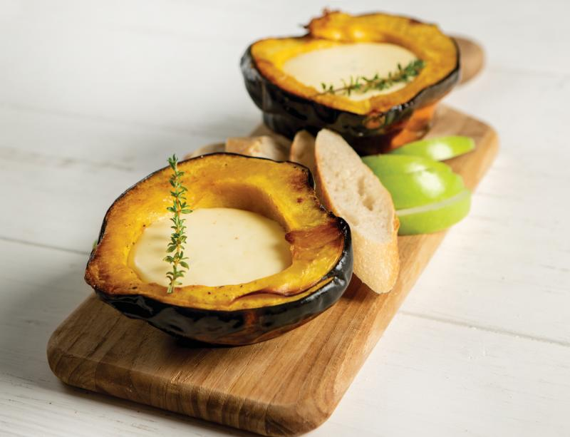 beer and cheddar fondue in roasted acorn squash
