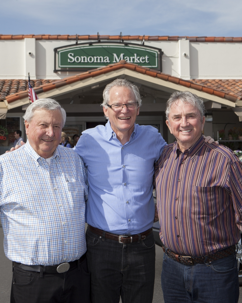 Don Shone and Dale Downing (left and right), co-owners of Sonoma Markets, celebrate with Eric Stille, president and CEO of Nugget Markets.