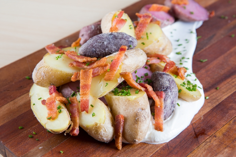 Salted potatoes with bacon and chives