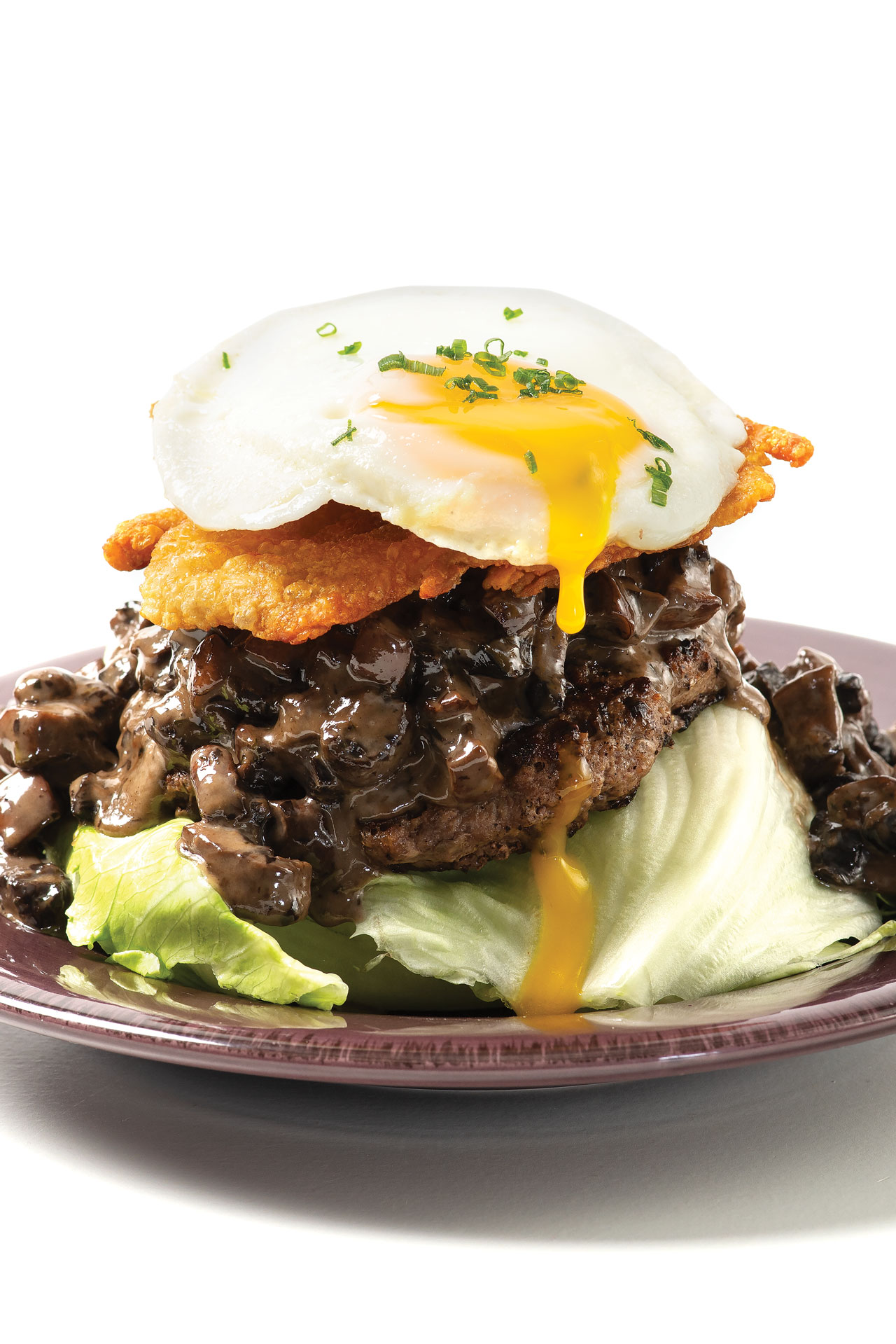 low-carb bison burger with chicken skin, a fried egg and no bun