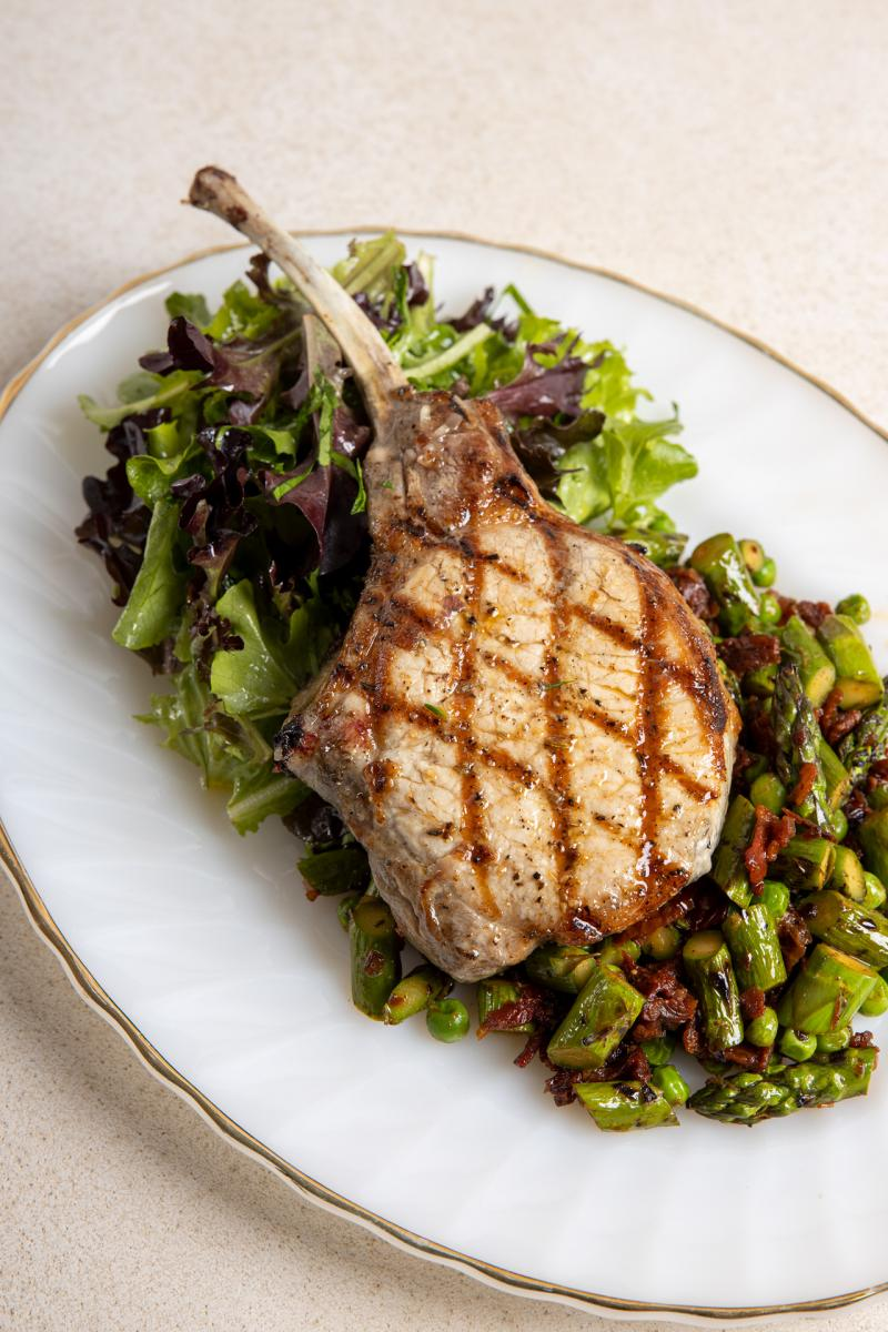 Grilled Tomahawk Pork Chops with Asparagus & Sun-Dried Tomatoes