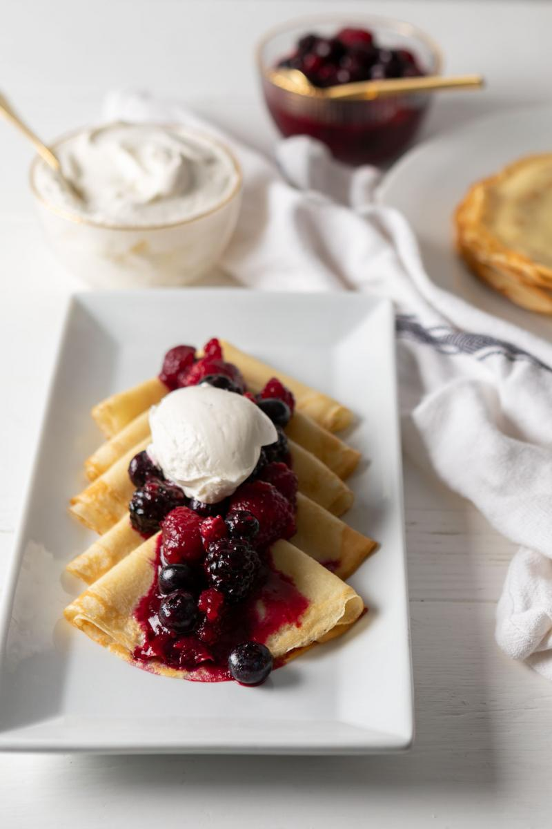 Breakfast Crepes with whipped creme fraiche and mixed berries