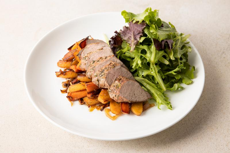 pork tenderloin with roasted quince and mixed greens