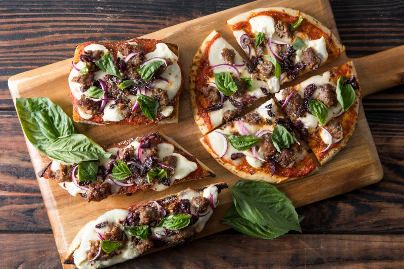 Sausage pizza on a variety of crusts