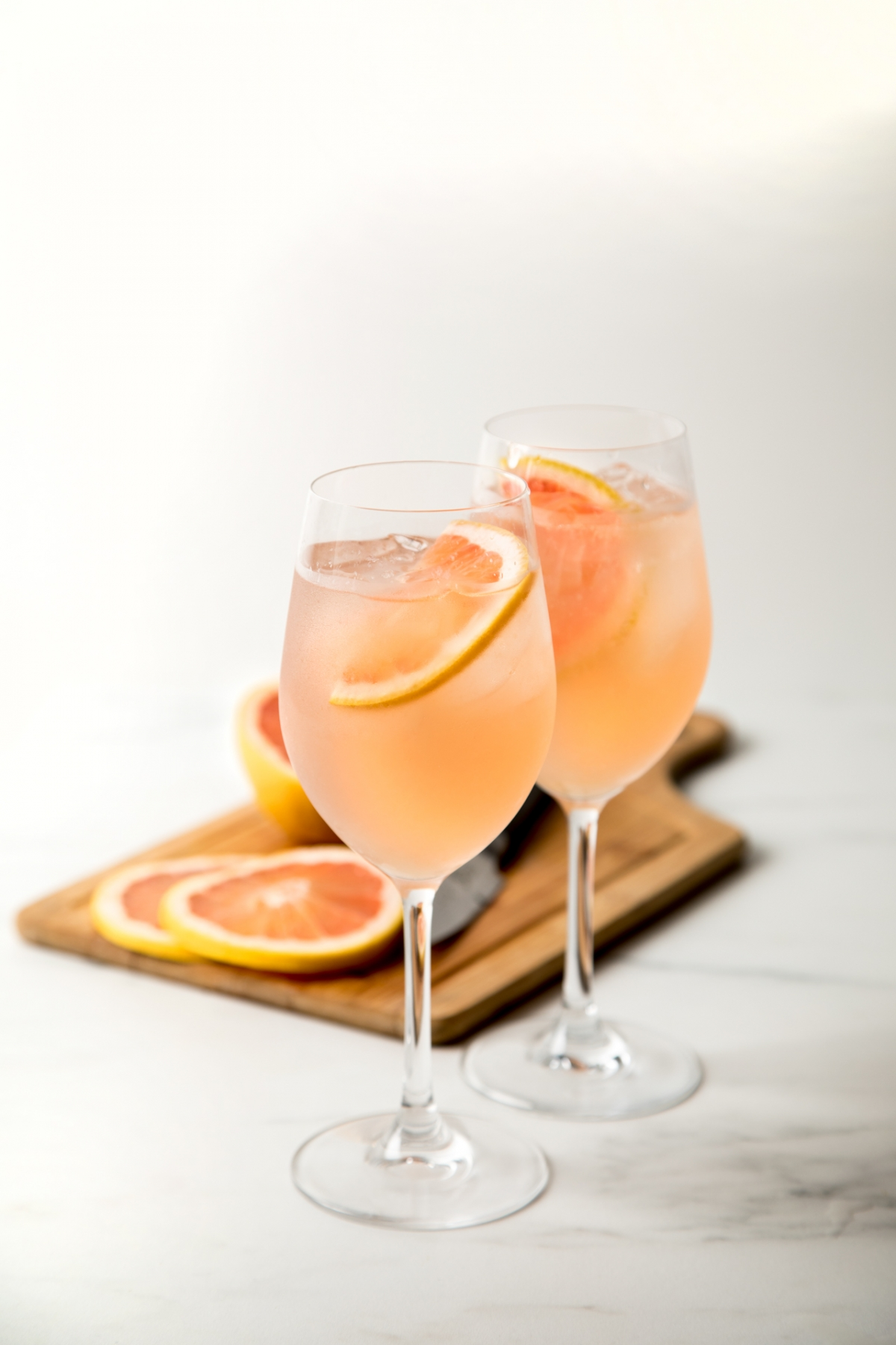 sparkling rose cocktail with grapefruit in the background