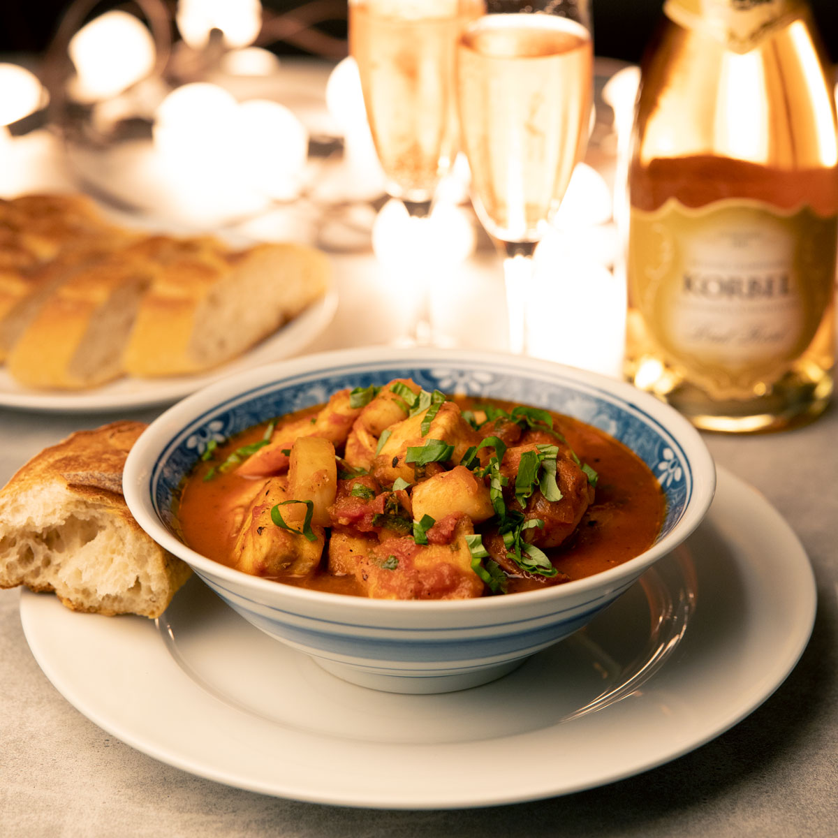 cioppino with sparkling wine and bread