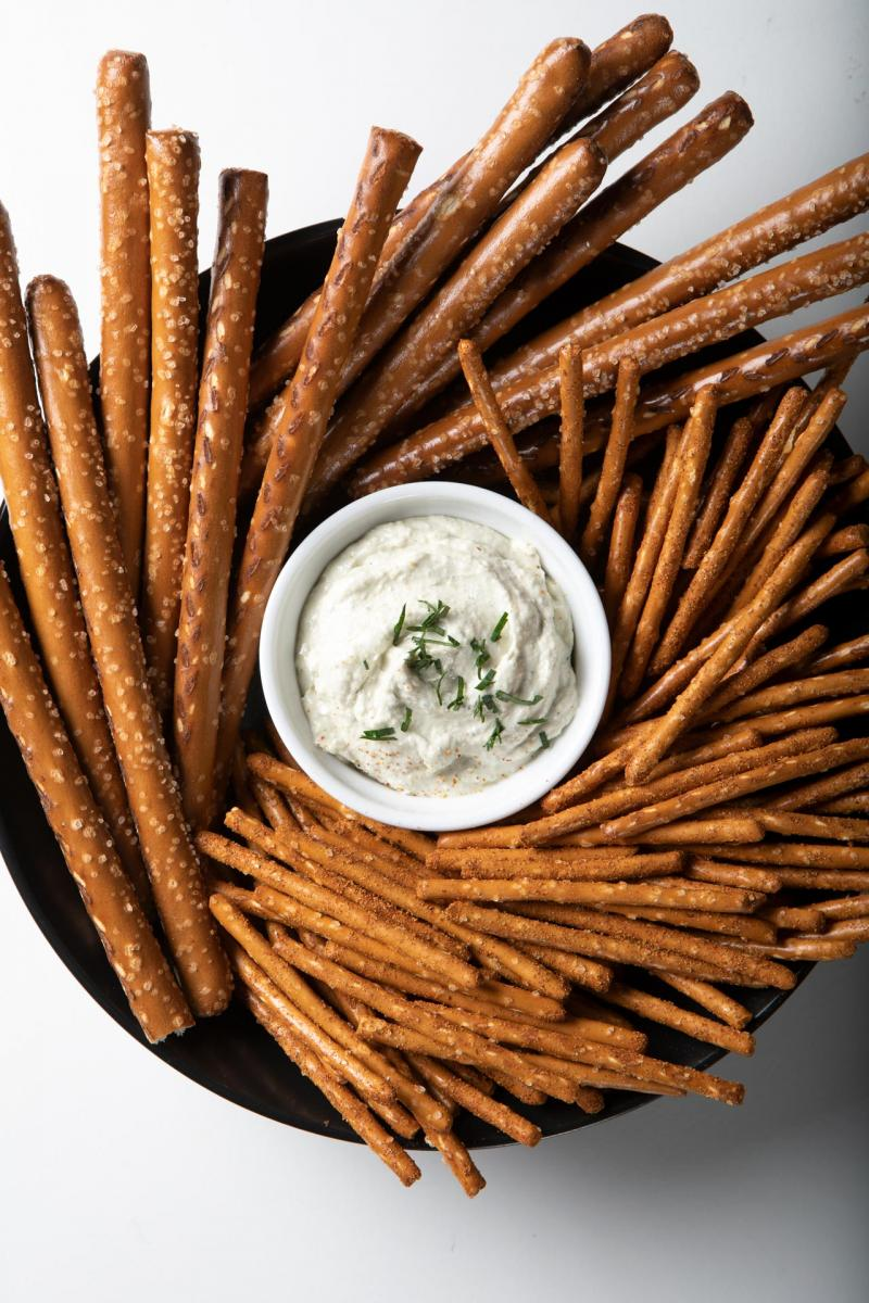 spicy pretzel sticks in a bowl with dip