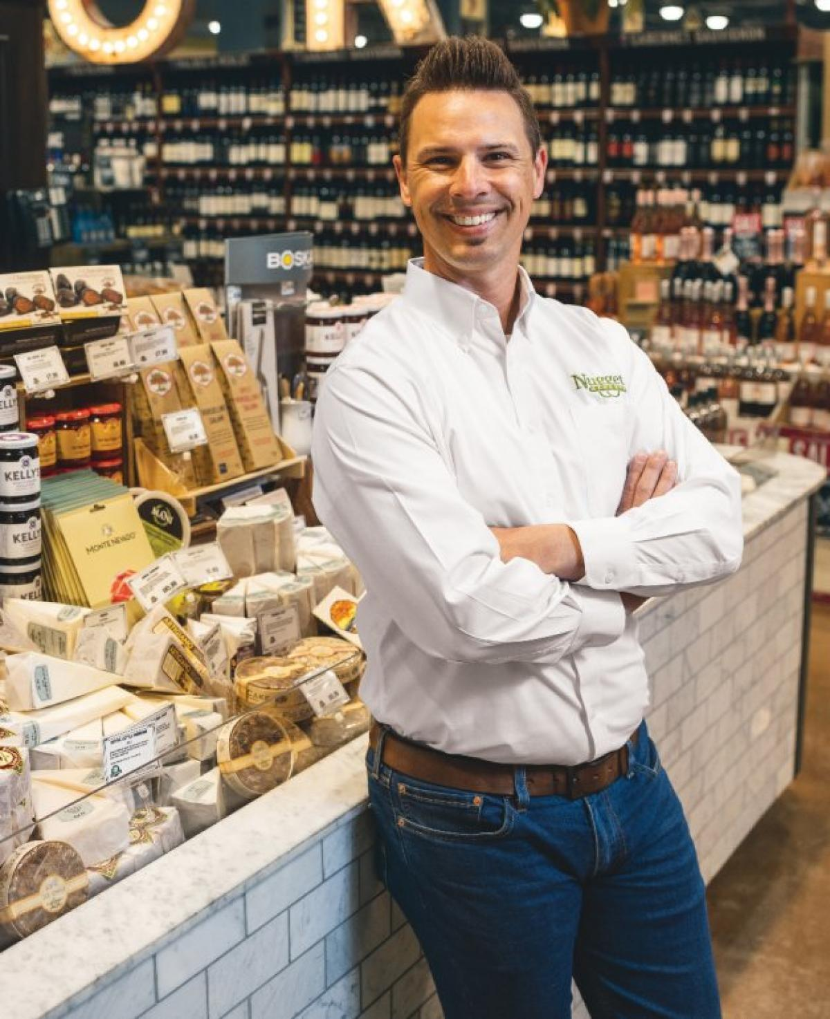 Jeremy Patin standing at cheese counter