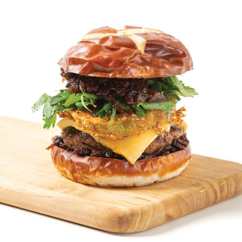 cajun beef burger on a wooden board