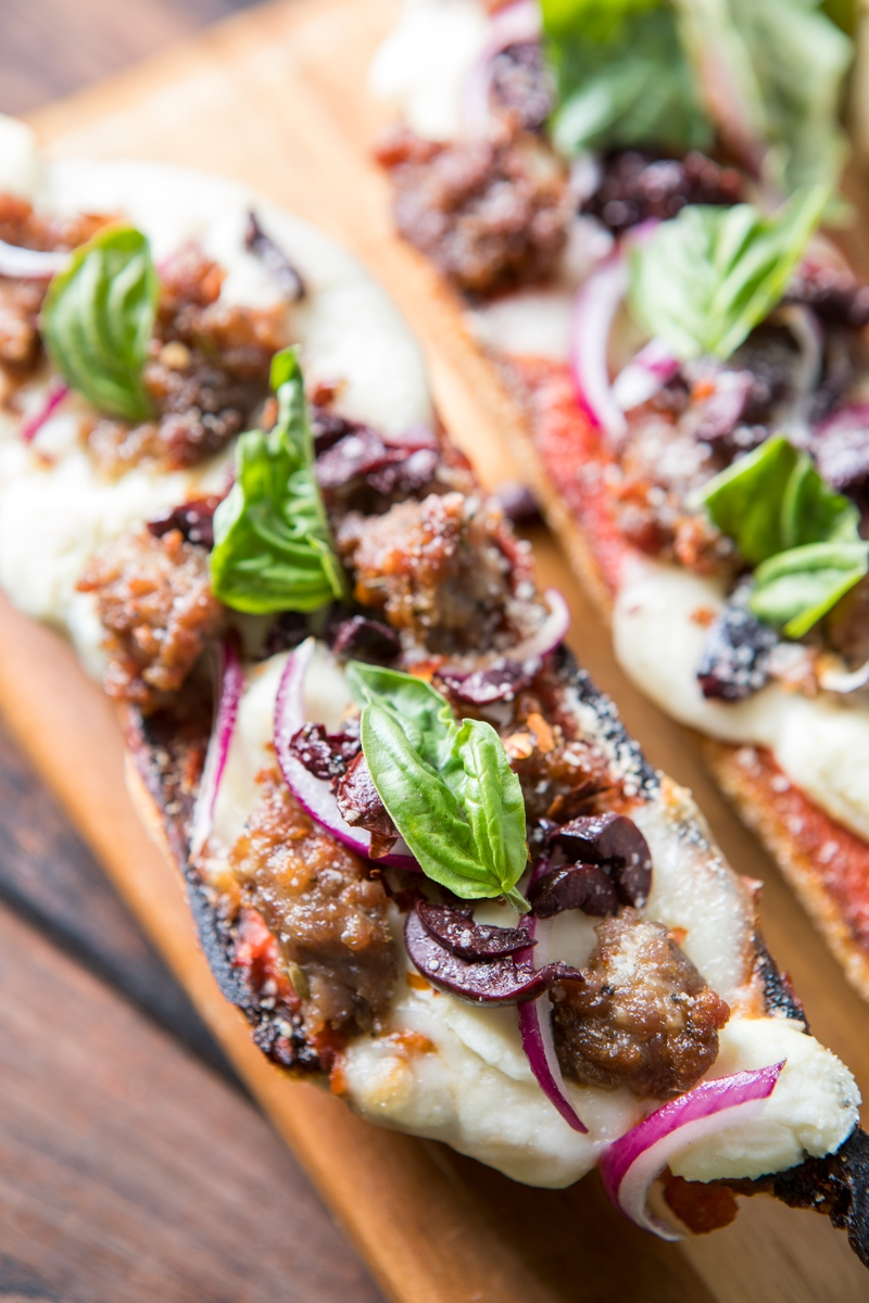 Sausage pizza on sliced bread crusts