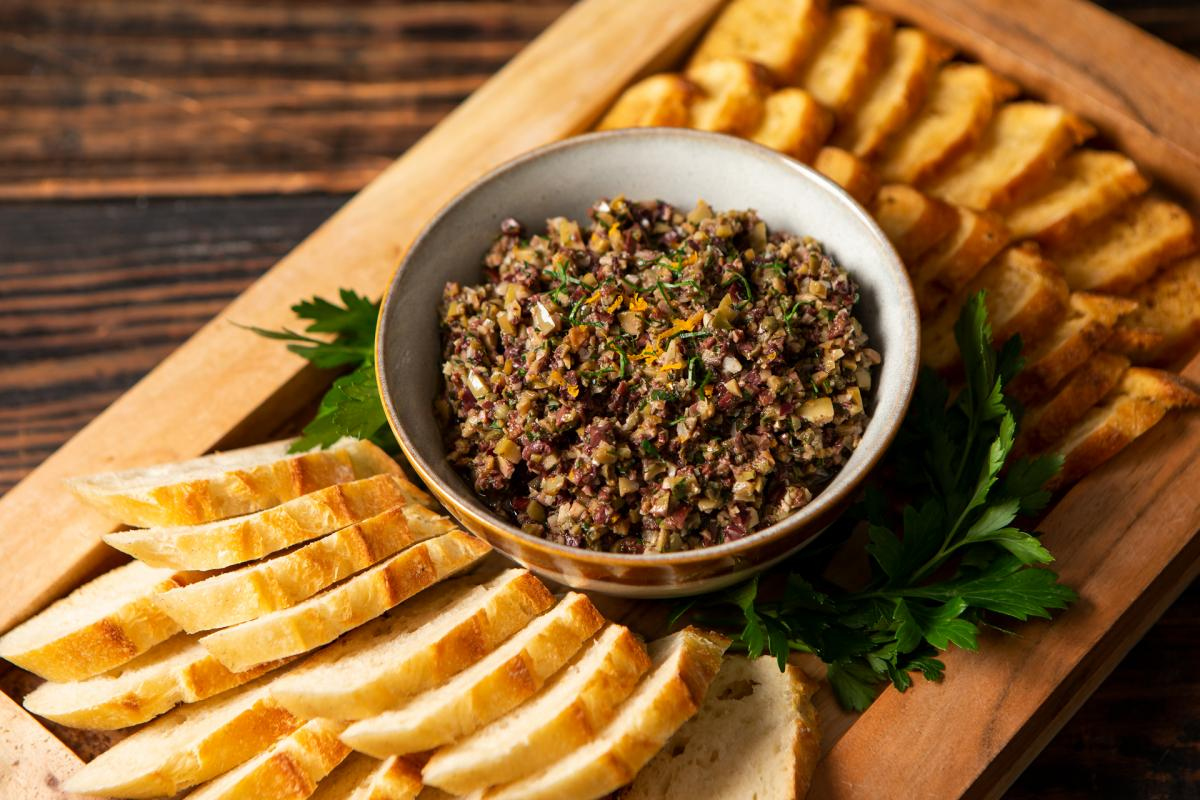 olive tapenade in bowl with crostini
