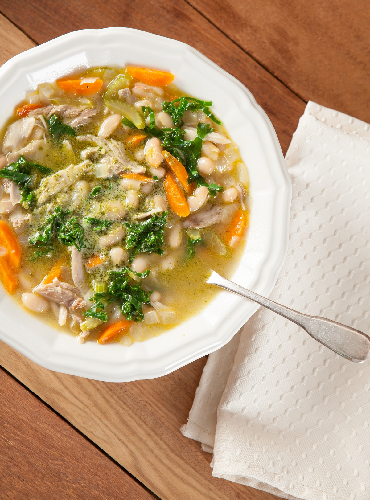 tuscan chicken and white bean soup in a bowl