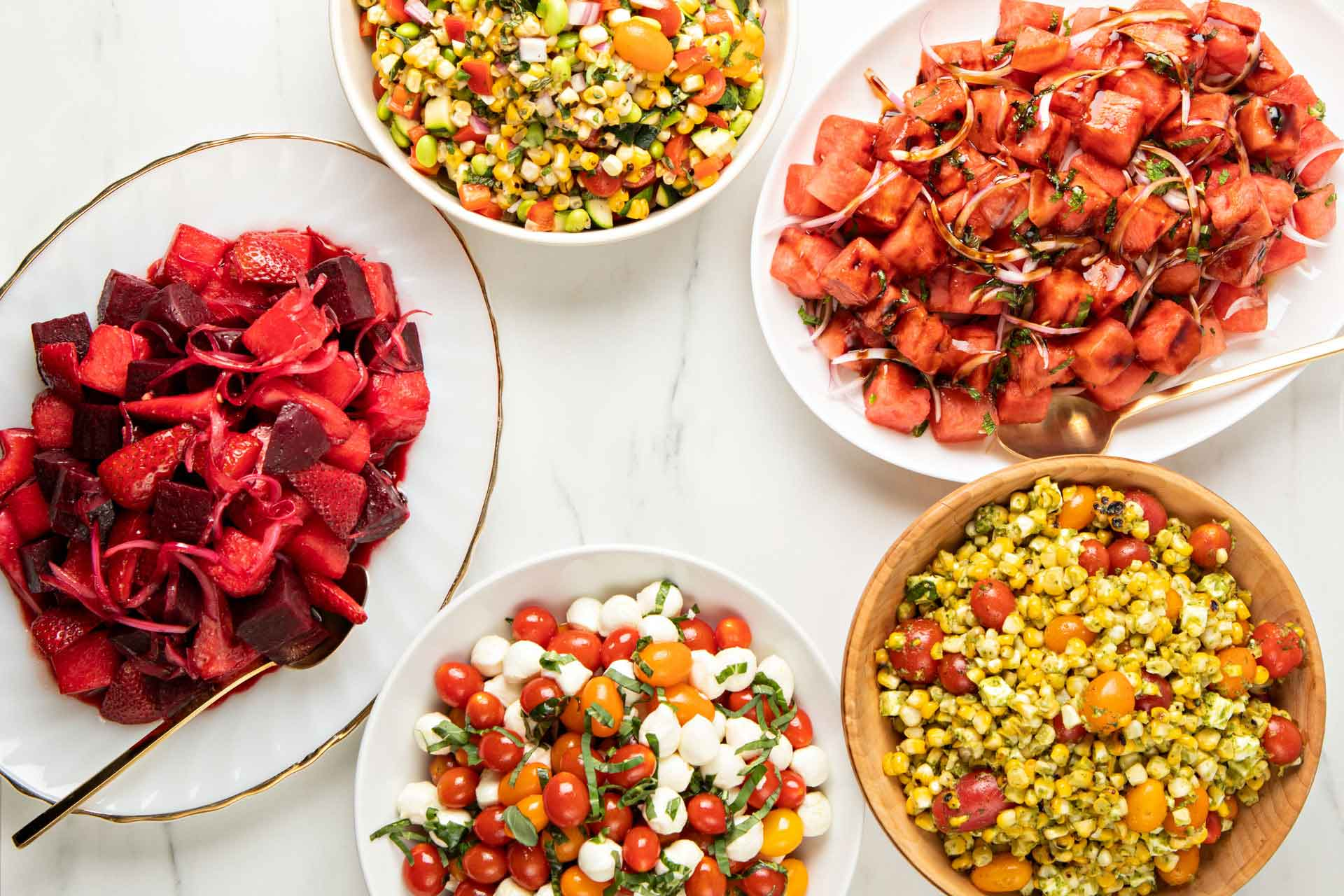 Strawberry beet, corn, caprese, and watermelon mint salads