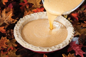 pouring pie puree into crust